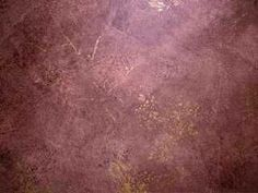 Faux painted wall with color wash of dark brown and black on tan base coat. Metallic gold was added with a sponge and fines lines with a fea...