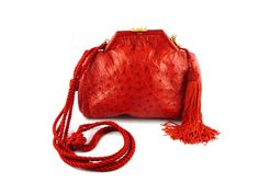 Gorgeous RARE and very attractive vintage red ostrich bag from the House of FENDI, featuring a purse wallet.  Red ostrich leather body, removable