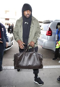 Fashion lover: Kanye wore one of his Yeezy jackets and a hoodie from his Yeezus tour as he said he didn't want to talk about the social media beef