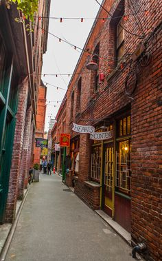 Fan Tan Alley, looking south towards Pandora Avenue. From 1910 to the construction of brick buildings between Cormorant (now Pandora) and Fisgard created the walls of Fan Tan Alley. Victoria Bc Canada, Victoria British Columbia, Vancouver British Columbia, Cool Places To Visit, Great Places, Places Ive Been, Places Worth Visiting, Tourist Sites, Story Of The World