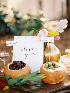 Olives in bread bowls.  Photography: Chelsea Scanlan Photography - chelseascanlan.com  Read More: http://www.stylemepretty.com/2013/10/08/jewel-tone-inspiration-shoot-from-chelsea-scanlan-bon-wed/