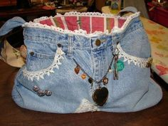 tote purse made from old denim blue jeans and found trinkets and bits of lace and vintage fabrics.