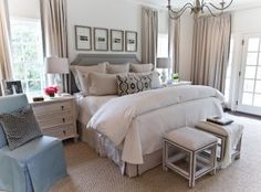 transitional-bedroom-boasts-a-black-and-white-photo-wall-over-headboard-upholstered-in-gray-fabric-on-queen-bed-dressed-in-natural-linen-bedding-flanked-by-3-drawer-distressed-nightstands-topped-with.jpg 287×212 pixels
