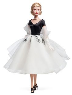 Grace Kelly Barbie  The doll is wearing a reproduction of one of the dresses Grace wore playing character Lisa Fremont, a socialite.