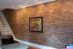 Faux exposed brick wall vaneer. I wonder if it can be pulled off to look real or if it would just look cheesy?!