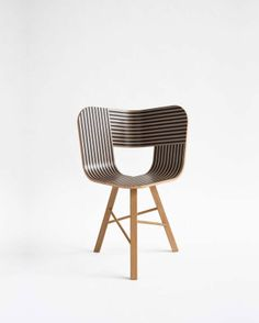 Tria chair for Colé from Lorenz+Kaz (2011) is a chair that recalls the impossibile forms of Dutch graphic artist and engraver M.C. Escher, defining itself in a game of twists and elusive leak. The corolla-shaped shell . . . in curved plywood . . . oak. http://www.lorenz-kaz.com/#/emily-london/