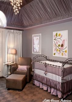 brown & purple girl's nursery design with chocolate brown velvet glider & ottoman, iron crib, lilac purple crib bedding, gray walls paint color, aluminum wine table and Amy Ruppel art.