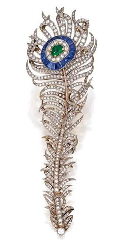 ( Imagine who wore this broach and how the beauty of a peacock feather inspired such a magnificent piece as this) Platinum-Topped Gold, Emerald, Sapphire and Diamond Brooch, circa 1900.  Designed as a peacock feather, the eye centered by a fancy-cut cabochon emerald framed by 16 calibré-cut sapphires, further set with round and single-cut diamonds.