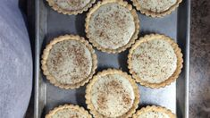 The sugary crust dough is pressed into the pie tin and baked. The sweet, milky thick custard filling is then poured into the baked shell, sprinkled with cinnamon and chilled. Makes two lovely pies.