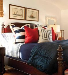 Interesting comforter and pillows; not a fan of the wall color or bed frame though.