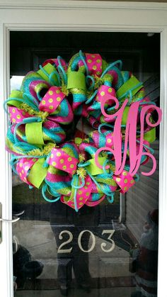 This is made with a deluxe striped mesh, two types of wired ribbon, deco flex tubing, and a 12 hand painted monogram of your choice.  This