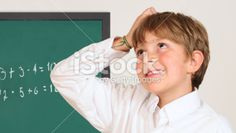 Boy thinking and scratching his head. Royalty Free Stock Photo