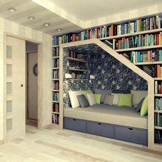 Bliblioteca y zona de descanso y lectura en una pared | Decoración 2.0