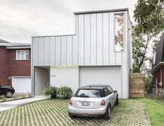 This house is a surprising solution for narrow lots, using natural ventilation and lighting: http://inhabitat.com/sculptural-holy-cross-house-uses-passive-solar-energy-and-natural-ventilation/
