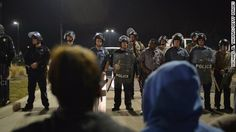 """Tensions are high after the shooting of two officers in Ferguson, Missouri, so state and county police took over as protest security Thursday. Meanwhile, Ferguson Police will remain responsible for """"routine policing services"""" in the city."""
