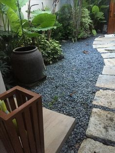 Limestone with grey big pebbles - I believe there is a lot of lime stone in the area. Do check if this color is available in big slabs and can it be a good cladding