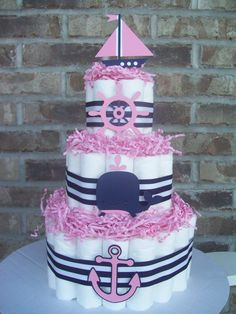 Ahoy! This 3 tier cake is the perfect addition to your nautical baby shower. It is made with three tiers of premium diapers, adorned with cardstock nautical pieces, beautiful ribbon, and paper shred to top it off! :)    Ingredients:  ~55 Sz 1 Pampers Swaddlers Diapers  ~4 Nautical Themed Cardstock pieces      We can customize these cakes! Convo me to set up a custom listing. I can make these in anlmost any animal or theme you would like. Toppers, paper shred colors, and ribbon colors and…