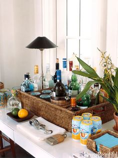 Organized bar. Design: Tom Scheerer. housebeautiful.com #home_bar #basket #beach_house
