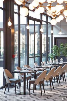 Additional seating in the bar area of Mario Batali and Joe Bastianich's new restaurant offers the full menu, which includes reimagined Italian dishes such as baked clams and grilled calamari.