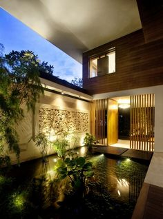Modern Balinese pond at iconic Meera Villa on Sentosa Island in Singapore by Guz Architects