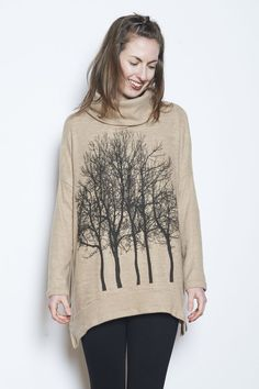 This chic, ultra soft poncho featuringour classic Fairytale Trees design will keep you warm and cozy on the coldest winter day. Pair it with slacksand your favorite pendantnecklace to dress it up, or wear it long over leggings for a casual weekend look. Please note we have two additional colors options available;Select your preferred color above CareMachine wash cold / tumble dry low or hang dryFits true to size.