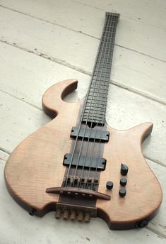 Polyphonic Workshop headless 5-string bass with through-body bridge