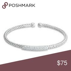 Diamond bracelet Half carat total weight simulated diamond braided bangle. Sterling silver braided bangle bracelet with pave simulated diamond bar 6.5 inches in length weight is approximately 1/2 carat total weight.comes with original box.MINT CONDITION GORGEOUS! Retail $160 helzberg Jewelry Bracelets