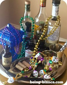 Quick fix Mardi Gras decor - a few beads + toss like you are in the parade yourself = festive decor!