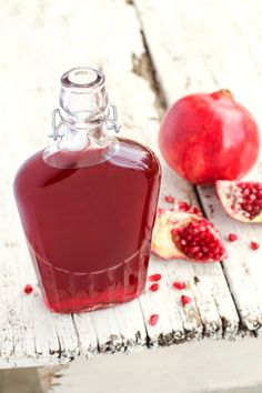 Pomegranate Shrub Recipe from afarmgirlsdabbles.com - This Pomegranate Shrub Recipe will give you a gorgeous ruby syrup, sweet and tart and delicious. Stir it into bubbly water, your favorite cocktail, or a salad vinaigrette for bright and tangy pomegranate flavor.