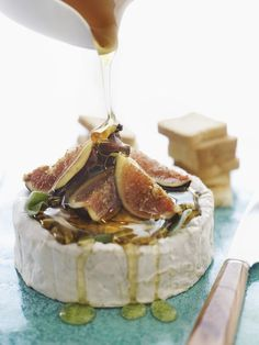 Figs and wheel of brie.