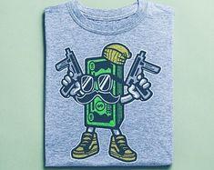 Items similar to Cash Rules Skater Shirt - Graffiti Shirts, Street Art Apparel, Unisex Clothing on Etsy Surf Shirt, T Shirt, Skater Shirts, African Safari, Vintage Shirts, Tshirts Online, Graffiti, Street Art, Unisex