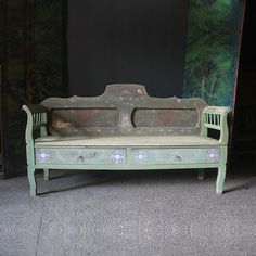 """A pretty antique pine European bench with chalky pale green paint and folk painting, love hearts, flowers and date """"1849"""". This bench was almost certainly a marriage piece, it has two drawers and marriage date. Catalogued and provenance indicates it is Swedish though might just as easily originate from the painted furniture region of Transylvania.  Kolosvar      c.1840  H: 105cm (41.3in) W: 190cm (74.8in) D: 54cm (21.3in)"""
