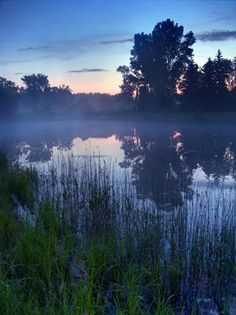 Ionia, Michigan, USA  Fog Lifting off a Pond as the Day Breaks...