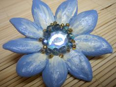 blue crystal, glass and pumpkin seed flower brooch