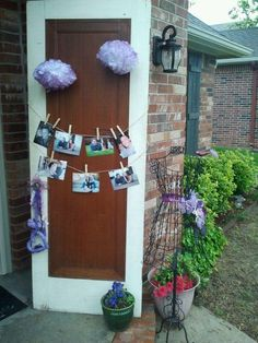 Used an old door to hang pictures of the bride and groom at the enterence to bridal shower...