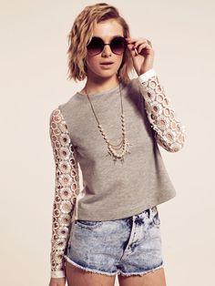 sweatshirt w/ eyelet sleeves