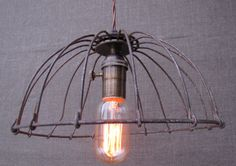 Rustic basket light. I love this etsy store!