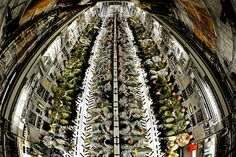 U.S. Soldiers assigned to the 3rd Brigade Combat Team, 82nd Airborne Division and Canadian soldiers with 3rd Battalion, The Royal Canadian Regiment fill the cargo area of a U.S. Air Force Globemaster III aircraft during an in-flight rigging mission during a joint operational access exercise (JOAX) at Pope Field, N.C., Feb. 9, 2012. (U.S. Air Force photo by Staff Sgt. Andy M. Kin/Released)    http://www.flickr.com/photos/soldiersmediacenter/6779492542/in/photostream