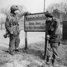 British airborne troops study a sign outside Hamminkeln during operations east of the Rhine 25 March 1945.