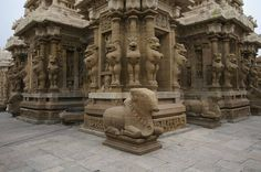 Nandi and lion sculptures on the the early 8th century CE Kailasanatha temple at Kanchipuram, Tamil Nadu, southern India.