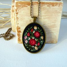 This pendant is hand embroidered. Pendant size: 50x32mm / 1,97x1,26 Size of central element: 30x40 mm / 1,18x1,57 Chain Length: 80 cm / 31,5