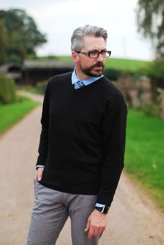 Menswear: shirt, tie and v-neck sweater