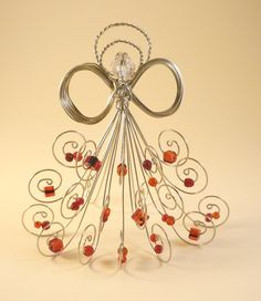Silver wire angel, assorted red glass beads, hint of black
