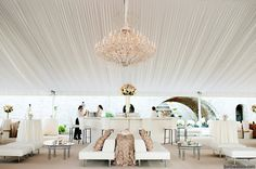 viva bella events | Cincinnati, Ohio | Kortnee Kate Photography | custom 16 foot white tufted leather bar from Camargo Event Rental | White wedding tent | wedding chandelier