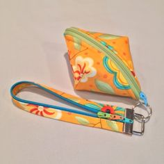 """Add our Fobio zip key lanyard to make an instant wristlet. Our split ring fits the hole on the zipper pull. Sweetpea Pods pattern, LGD135. Two 10"""" squares, a bit of fleece, and half a zip."""