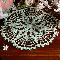 Springtime Doily Thread Crochet ePattern - Number of Designs: 1 doilyApproximate Design Size: diaDesigner: Hazel I. HenryOriginal Publication: Leisure Arts Leaflet Doilies For All Seasons Skill Level: Intermediate Description: Celebrate Spri Crochet Doily Patterns, Crochet Mandala, Thread Crochet, Crochet Doilies, Crochet Lace, Crochet Hooks, Free Crochet, Knitting Patterns, Crochet Table Runner