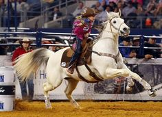 Nine year old Chayni Chamberlain of Stephenville, TX competes in the barrel racing event at The RFD-TV American rodeo at AT&T Stadium Sunday, March 1, 2015.