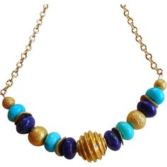 """Lapis, Turquoise and 21k Gold Vermeil Necklace Truly spectacular southwestern style necklace with Kingman turquoise and Lapis Lazuli with 21k gold vermeil beads and spacers. """"Vermeil"""" is a term that describes a coating of gold on sterling silver.  The necklace measures 19 inches with a gold vermeil lobster clasp closure."""