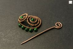 CNJoalharia Wire wrapped copper hairpin with green plastic beads.