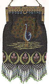Here we have another version of the peacock purse ... all done in sparkly black beaded background with brightly colored golds, blues, greens and pinks making up the peacock.  The purse is topped with a fabulous jeweled frame ... called Double because both the front and back are jeweled ... 16 jewels in all.  Bottom of purse is finished in a delightful lattice fringe in colors to match the purse.  Interior is lined in pale pink silk with blue French ribbon trim.  Overall in excellent…